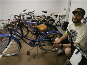 Andy Stepnick sits among bicycles belonging to the Toledo City Bicycle Co-op, which is headquartered at St. Mark s Episcopal. Mr. Stepnick is co-collaborator for the group.