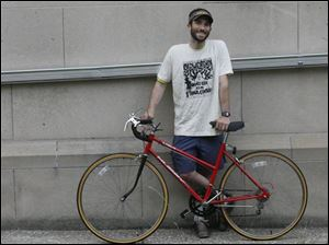 Bicycling is among modes of transportation Andy Stepnick uses when he s not driving a Toyota Prius.