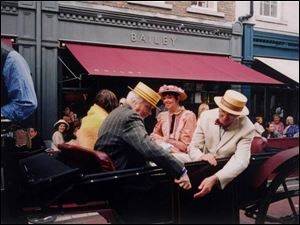 A carriage with people dressed in Edwardian garb arrives at Davy Byrnes pub on Bloomsday.