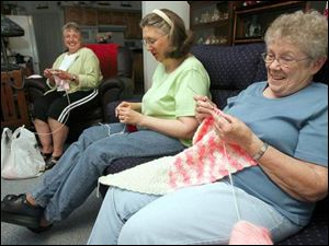 From left, Marilyn Roth, Christine Hampshire, and Betty Ten Eyck of Calvary Lutheran Church s prayer shawl ministry.
