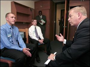 Gov. Ted Strickland, right, meets with Buckeye Boys State's top elected officials, Gov. James Evans, left, and Lt. Gov. John Jones, at Bowling Green State University. 'These guys are the cream of the crop,' Mr. Strickland said of the 1,189 soon-to-be high school seniors taking part in the hands-on government program.
