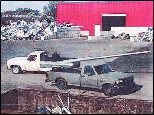A surveillance video from R&M Recycling Inc. shows a pickup truck with the missing pole.