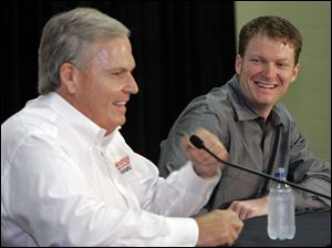 Rick Hendrick, left, owner of Hendrick Motorsports, shares a laugh with Dale Earnhardt Jr. during a news conference yesterday, when it was announced Earnhardt will join Hendrick.