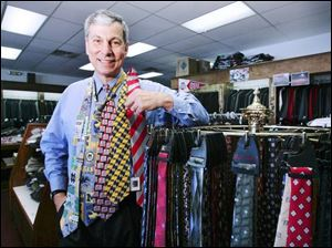 Fewer fathers will receive such traditional items as these neckties shown by retailer Jim Damschroder.