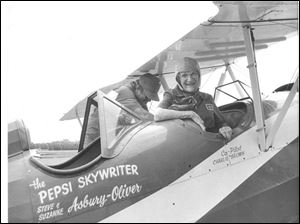 Blade staff reporter Millie Benson sits in the cockpit of ''The Pepsi Skywriter'' in this May 23, 1987 at Toledo Express Airport.