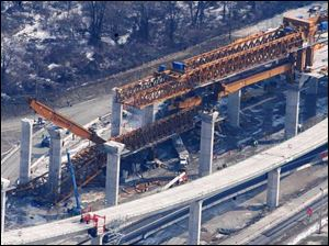 On Feb. 16, 2004, a huge gantry truss crane peeled away and crashed 60 feet to the ground.