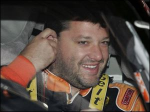 Tony Stewart waits to practice at Michigan International