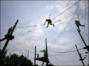 Niv Koren, center, of Israel climbs fearlessly on high ropes a