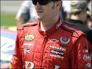 NASCAR driver Dale Earnhardt Jr., walks down pit row before the qualifying laps for Sunday's Citizens Bank 400 auto race at Michigan International Speedway in Brooklyn, Mich., Friday, June 15, 2007.