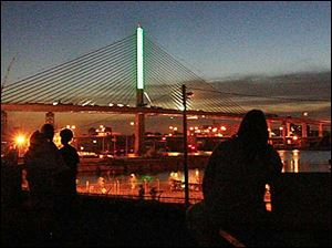 The first lighting of the Veterans Glass Skyway Bridge