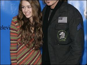 Miley Cyrus, left, and Billy Ray Cyrus