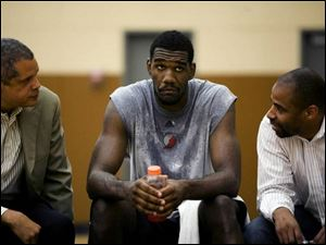 Greg Oden center, sits with his agents Bill Duffy, left, and Mike Conley Sr. during a news conference after Oden worked out at the Portland Trail Brazers' practice facility in Tualatin, Ore. Wednesday, June 20, 2007. The Trail Blazers have the No. 1 selection in the June 28th NBA basketball draft, and Oden, a forward from Ohio State, figures to be one of the top picks