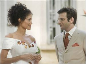 Angelina Jolie and Dan Futterman in A Mighty Heart.