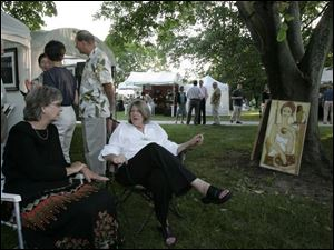 Cindy Felver, left, of Dayton, and Kathy Funderburg of Bryan, Ohio, at the Crosby Festival of the Arts.