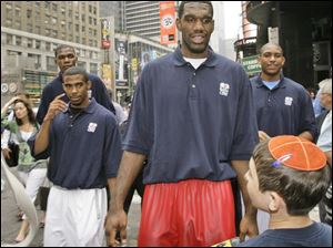 Greg Oden was a big attraction on the streets of New York yesterday, along with, clockwise from left, Ohio State teammate Michael Conley Jr., Kevin Durant and Al Horford.