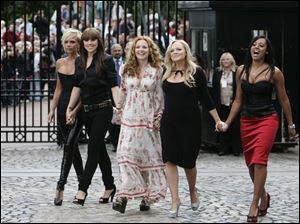 The reunited Spice Girls, Victoria Beckham, left, Melanie Chisholm, Geri Halliwell, Emma Bunton and Melanie Brown, pose today on the grounds of the Royal Observatory in London.