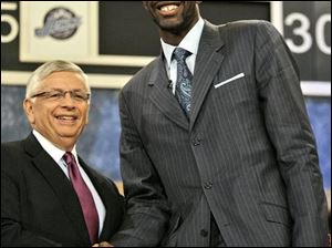 Greg Oden shakes hands with NBA commissioner David Stern after being taken with the draft's first pick. Memphis used the No. 4 pick for Ohio State's Michael Conley.
