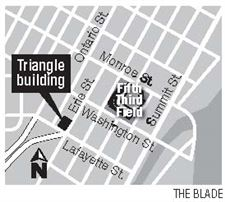 Lansing-men-pay-575-000-for-Erie-St-Triangle-Building-2
