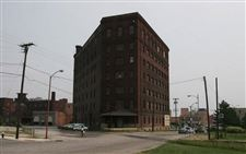 Lansing-men-pay-575-000-for-Erie-St-Triangle-Building