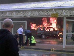 Flames rise from a Jeep after the SUV was rammed into the main terminal of Glasgow airport on Saturday.