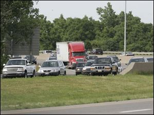 Traffic on I-75 south is stymied at Wales Road yesterday. The AAA figures 41.1 million Americans have holiday travel plans.