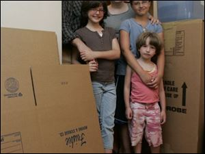 Rabbi Barry Leff, his wife, Lauri Donahue, and children Lizzy, 9, Katherine, 11, and Devorah, 6, are packing for their move to Israel.