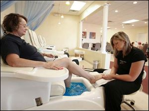 Judy Roepke relaxes as Mandy Highley gives her pedicure.