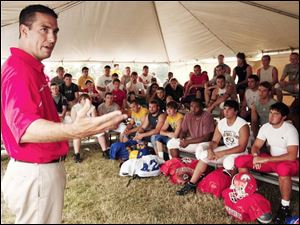 Ohio State assistant coach Luke Fickell talks to players who are preparing for Friday s regional all-star football game.