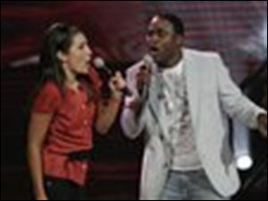 "Wayne Brady encourages contestant Kate Moeser during an episode of the new Fox series ""Don't Forget the Lyrics!"""