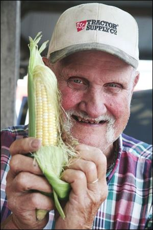 Lawrence Helle, Jr., holds one of the stars of the show,