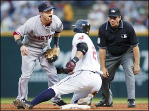 Red Sox second baseman Dustin Pedroia yelps after bein