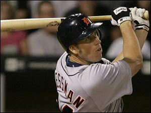 Tigers first baseman Mike Hessman, who was called up from the Mud Hens yesterday, hits a two-run single in the seventh inning to score Magglio Ordonez and Carlos Guillen.