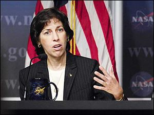 Ellen Ochoa, director of flight operations, NASA Johnson Space Center, Houston answers questions during a news conference to discuss the findings of two reviews regarding astronaut medical and behavioral health assessments today.