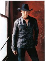 Trace-Adkins-balances-rowdy-fun-loving-hits-with-serious-songs