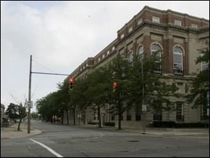 The imposing Toledo Club building looms over the intersection of Madison Avenue and 14th Street in the western reaches of downtown Toledo.
