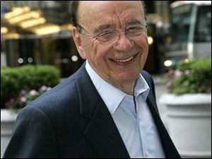 Rupert Murdoch arrives at the News Corp. building in New York today.