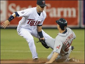 Grady Sizemore, one of the few Indians to reach base, is tagged out by Twins shortstop Jason Bartlett on a steal attempt.