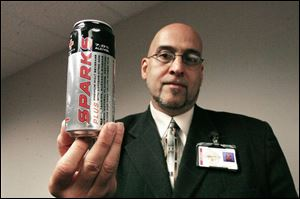 Probation officer Johnny Carrillo displays an alcohol-containing