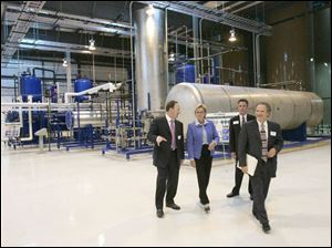 Gov. Jennifer Granholm tours the plant with owners Terry Nosan, left, Brad Schram, and Michael Horowitz.