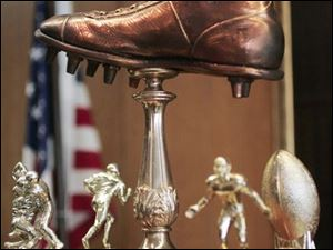 Hilton Murphy not only was the father of the Shoe Bowl, but he also designed its trophy, a size 14 bronze shoe.