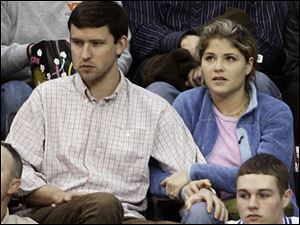 Jenna Bush watches the ACC men's championship basketball game between Georgia Tech and Duke on March 13, 2005, in Washington with long-time boyfriend, Henry Hager, now her fiance.