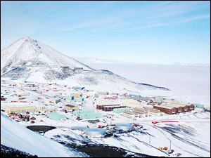 The McMurdo research station is situated along the coastline of Ross Island in Antartica.