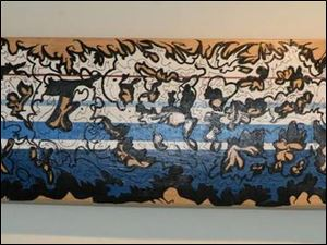 One of seven skateboard decks by Jared  MEDE  Oberle on display on the fourth fl oor of Space 237 in downtown Toledo.