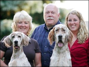From left, Diane, Terry, and Lindsey Kuhn, of Perrysburg, with English setters Izzy and Logan.