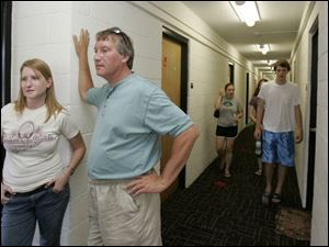 Kristina Karbula, 19, and her father, Mick Karbula of Lexington, Ohio, discuss security features near Ms. Karbula's new dorm room in Dowd Hall at the University of Toledo. 'I was really impressed with the safety here,' Ms. Karbula said.