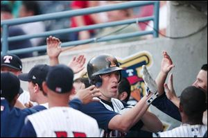 Mike Hessman is welcomed in the dugout after hitting his 30th home run this season. He leads the IL in RBIs with 95.
