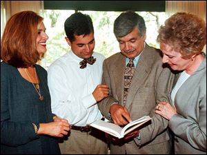 Daughter Natasha Hussain- Black, left, son Monie Hussain, S. Amjad Hussain, and his late wife, Dorothy, at a book signing in 1998.