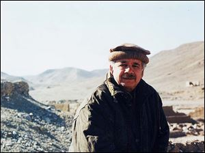 Dr. Hussain pauses during a trip to Afghanistan, after which he wrote a series on the shadowy Taliban, whom he had interviewed in their native language. It was published in The Blade in 2001.