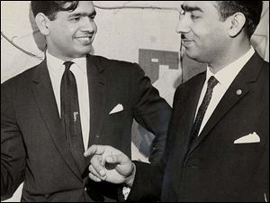 In 1963, Dr. Hussain, at left, chatted with Syed Yusaf Ali Shaw, the mayor of Peshawar, West Pakistan.