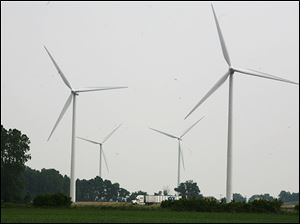 Four wind turbines operate at the Wood County Landfill in Bowling Green. Wind power is a source of renewable energy.